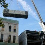 Lifting the HVAC unit to the roof of the Sigal Museum